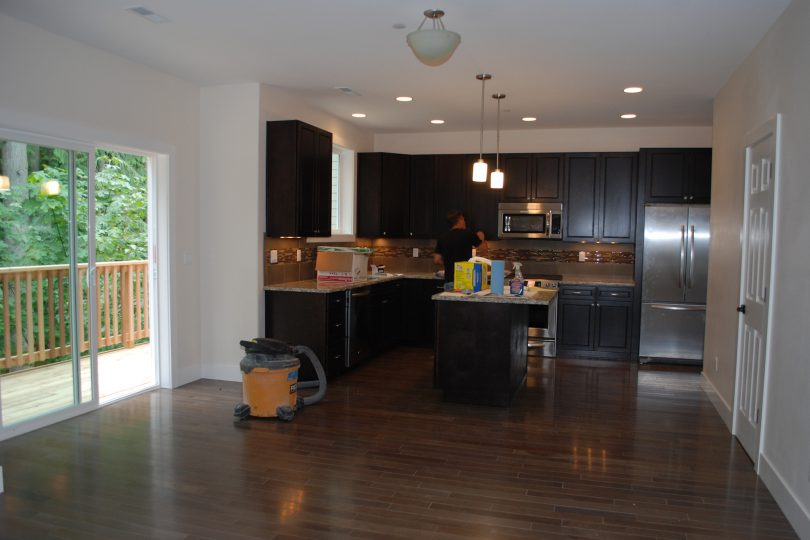 Cherry wood floors, custom cabinets